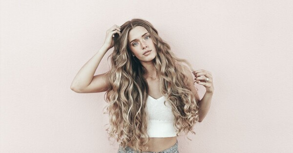natural hair care products-girl-with-long-curly-brown-hair