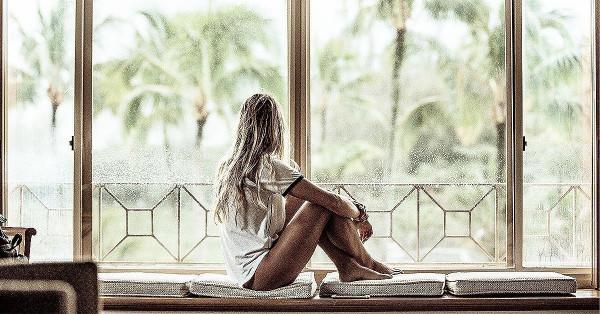 girl-sitting-on-window-sill