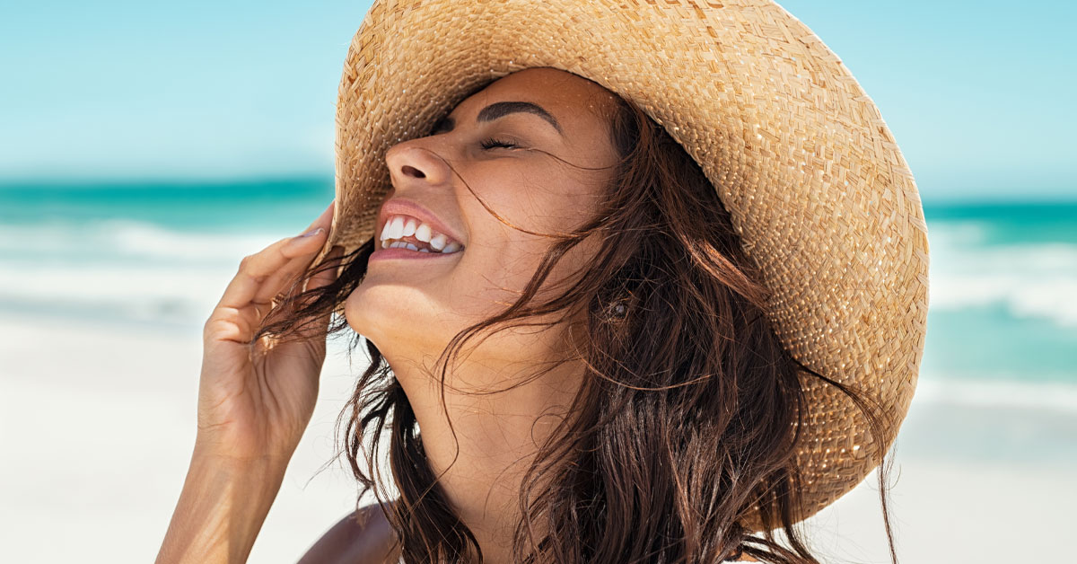 must have summer natural skincare-girl at beach