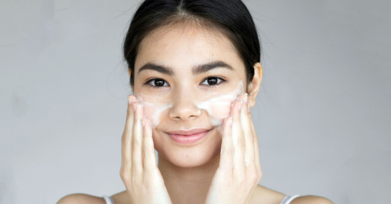 How to Get Rid of Dead Skin on Face - young girl exfoliating her face