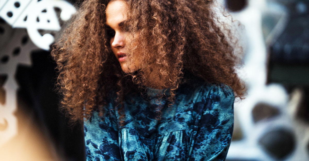 Natural Hair Care For Dry Hair Woman With Big Curly Hair