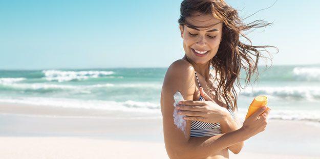 Natural Skin Care - Woman Applying Sunscreen
