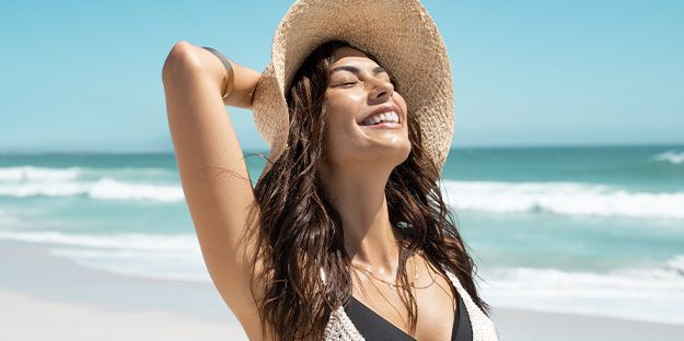 natural-skin-care-products-woman-enjoying-the-sun